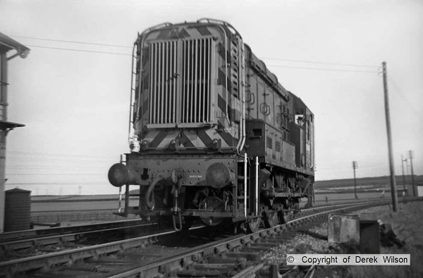 A unidentified class 08 0-6-0 diesel shunter is seen passing Clipstone West signal box, heading back to Langwith shed (41J)..The box can just be seen to the left of the picture. The loco would be one of a later batch allocated to Darnall (41A) D4049 - D4074 which were delivered in 1961 so the picture was probably taken that year. I think this was taken on a Saturday & the shunter was retuning to Langwith shed after spending the week as Mansfield Concentration Sidings pilot.