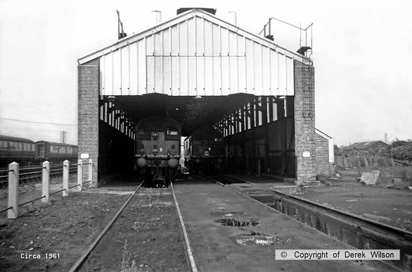Yarmouth Southtown deisel depot, with two BR type 2 Bo-Bo's visible inside. These would be from the earlier batch which became class 24 under 'T.O.P.S. The shed was the former steam shed, as is evident by the ashpit in the foreground. July/August 1961