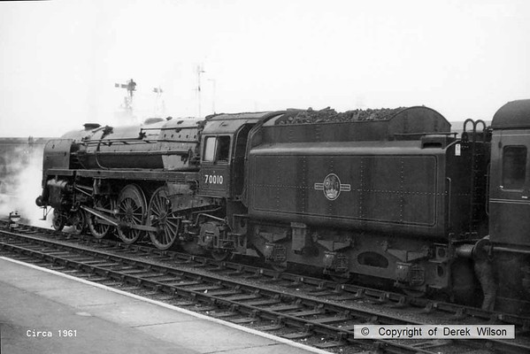 BR Britannia 4-6-2 no. 70010 Owen Glendower is seen at Norwich in the summer of 1961. Taken during my summer holiday so was possibly late July, but more likely early August.
