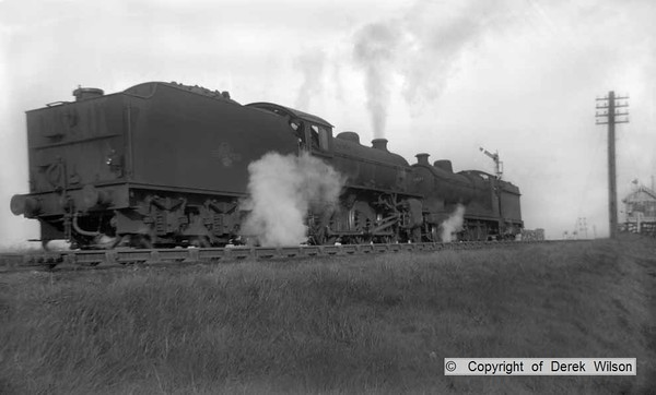 A unlikely duo, Peppercorn K1 2-6-0 no.  62053 & Robinson O4 2-8-0 no. 63577 are captured passing Clipstone East junction, probably heading to Langwith (41J) engine shed. Clipstone East signal box can be seen in the distance, to the right of the picture. circa 1960