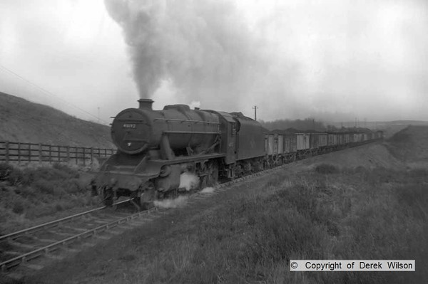 LMS Stanier 8F 2-8-0 no. 48192 is seen climbing the gradient on the former Midland Railway single track, leaving Clipstone colliery with a rake of loaded coal wagons. The loco would be allocated at Kirkby-in-Ashfield (16B).  circa 1960.