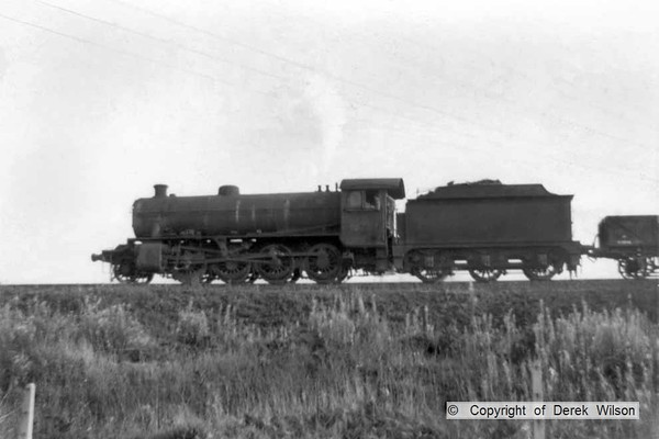 Another unidentified LNER O1 2-8-0, seen approaching Clipstone West junction, heading towards Shirebrook.  circa 1960