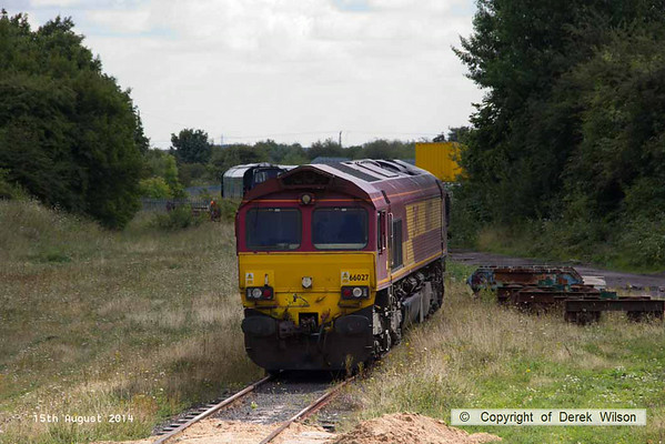 140815-007     DB Schenker class 66/0 no 66027 stands in the headshunt at W.H. Davis', Shirebrook.