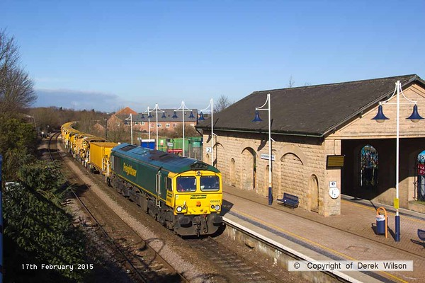 150217-002     Freightliner class 66/9 no 66952 passes through Mansfield Woodhouse with the longest train operating on the UK network, the HOBC, or High Output Ballast Cleaner, train 6Y11, 12.00 Gainsborough Tent Junctions to Stapleford  & S.C.C.E. siding. Well out of sight at the rear was 66562.