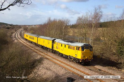 150224-011  Network Rail test train 3Q18, 08.18 Derby R.T.C. to Derby R.T.C. is captured at Ollerton, on the High Marnham Test Track. It is seen with class 31 no 31465 leading and DBSO 9702 at the rear.