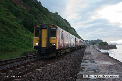 070703-003     A lash up of units led by class 150 n0 150234 passes along the Devon sea wall at Teignmouth, forming the 05.40 Exeter St Davids to Paignton.