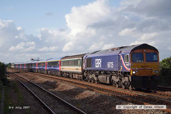 070703-016     GB Railfreioght class 66/7 no 66725 passes through Dawlish Warren in some late summer evening sunlight, powering refurbished FGW stock move 5Z90, 13.00 Derby (Bombardier) to Laira (Plymouth). The consist was made was Mk2 barrier 5790, Mk3's 41157/58, 42200/129/245/250, 44086 & Mk2 barrier 5737.