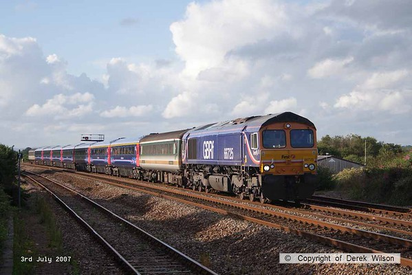 070703-015     GB Railfreioght class 66/7 no 66725 passes through Dawlish Warren in some late summer evening sunlight, powering refurbished FGW stock move 5Z90, 13.00 Derby (Bombardier) to Laira (Plymouth). The consist was made was Mk2 barrier 5790, Mk3's 41157/58, 42200/129/245/250, 44086 & Mk2 barrier 5737.