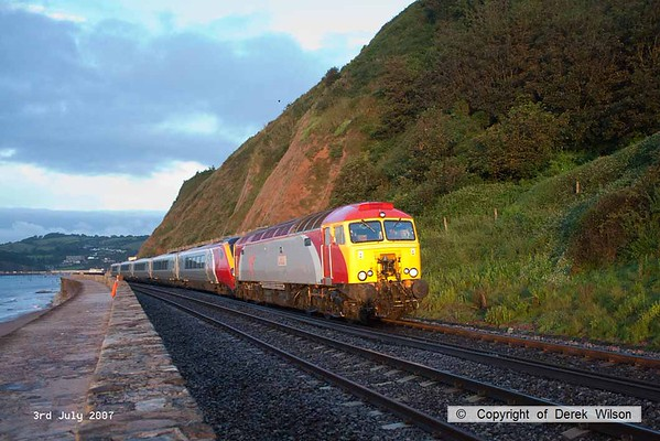 070703-001     Virgin Cross Country 'Thunderbird', class 57/3 no 57307 Lady Penelope is seen passing the sea wall at Teignmouth with a class 221 Voyager unit in tow. This was a crew training exercise and started at Plymouth, but I have no further details on it, the shot was taken at 05.36 in the morning.