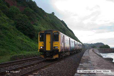070703-004     Another lash up of units, this time led by class 150 n0 150246, captured  passing along the Devon sea wall at Teignmouth, forming the 06.15 Exeter St Davids to Paignton.