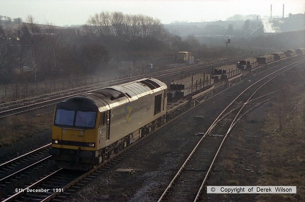 911206-002     Trainload Metals class 60 no 60044 Ailsa Craig passes Clay Cross with a northbound freight, consisting of loaded steel.