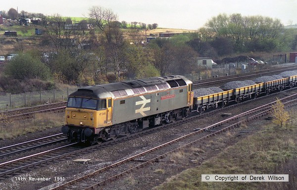 911114-009     Large logo class 47 no 47348 St Christopher's Railway Home passing Clay Cross with a northbound ballast train.