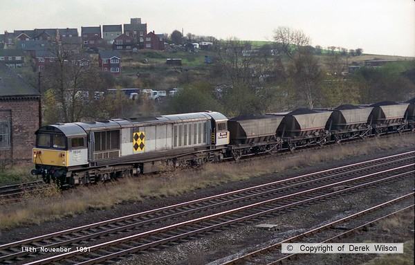 911114-010     Trainload Coal class 58 no 58041 Ratcliffe Power Station heading north through Clay Cross, on the Erawash line with a loaded coal train.