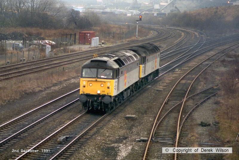 911202-002     Railfreight Distribution class 47's no's 47312 & 47152 running 'light' through Clay Cross, heading to Tinsley, Sheffield.