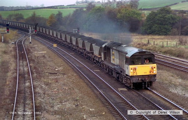 911114-011     Trainload Coal class 58 no 58025 passes Clay Cross with a southbound coal train, most likely heading to Rugeley or Didcot power station.