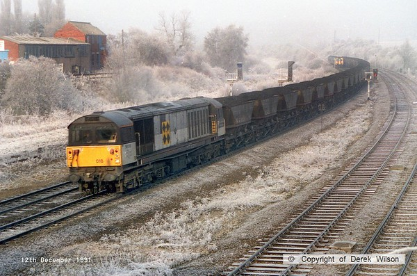911212-002     Winter Wonderland at Clay Cross, with Trainload Coal class 58 no 58018 High Marnham Power Station, powering a southbound loaded coal train along the up main.