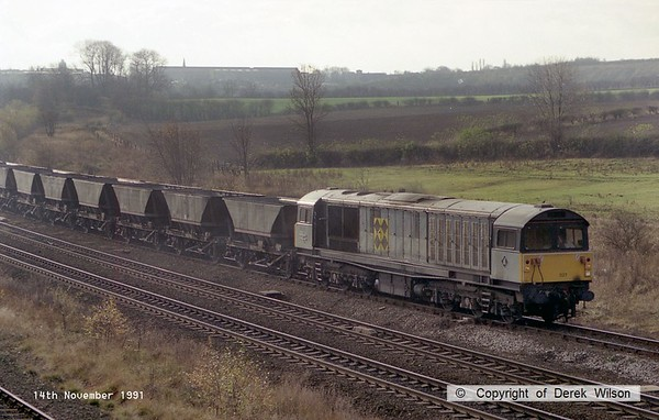 911114-004     Trainload Coal class 58 no 58027 passes through Clay Cross with a northbound loaded coal train.