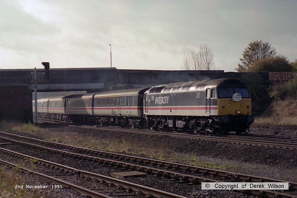 911102-001     Intercity class 47 no 47810 is captured passing through Clay Cross with a northbound charter.